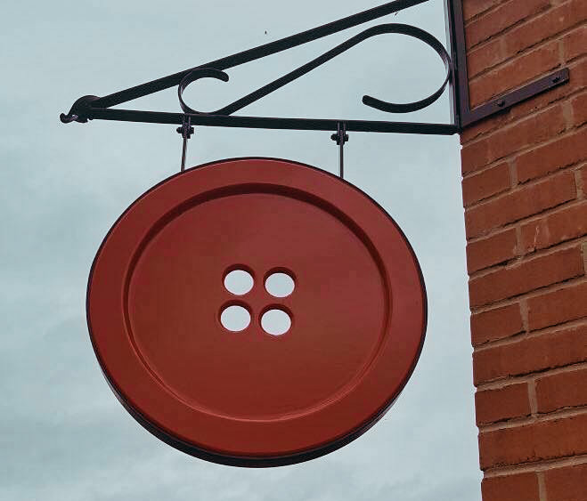 Ditzy Rose Makery features a large red button hanging outside